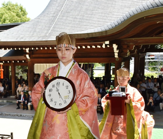 Women clad in ancient Japanese court dresses proceed holding clocks during an annual clock festival on June 10, 2016, at a Shinto shrine in Otsu, Shiga Prefecture in western Japan. Omi Shrine enshrines Emperor Tenji (626-672), said to be the founding father of the clock time system in Japan, as its deity. (Kyodo) ==Kyodo